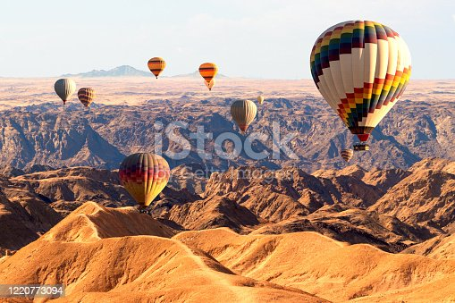 530709531 istock photo Colorful hot air  balloons flying over the moon valley mountain. Africa. Namibia. 1220773094