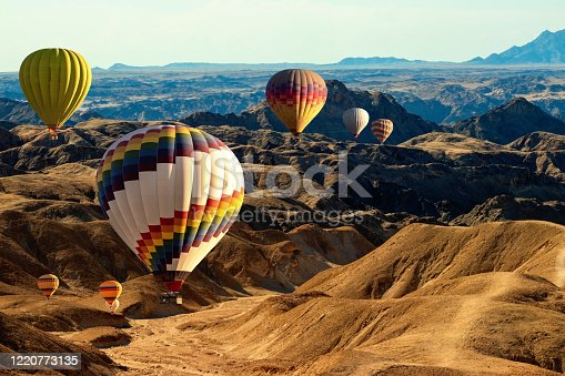 530709531 istock photo Colorful hot air  balloons flying over the moon valley mountain. Africa. Namibia. 1220773135