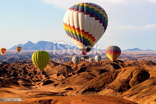 530709531 istock photo Colorful hot air  balloons flying over the moon valley mountain. Africa. Namibia. 1220773165