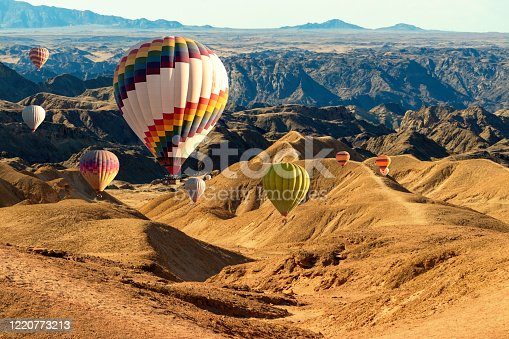 530709531 istock photo Colorful hot air  balloons flying over the moon valley mountain. Africa. Namibia. 1220773213