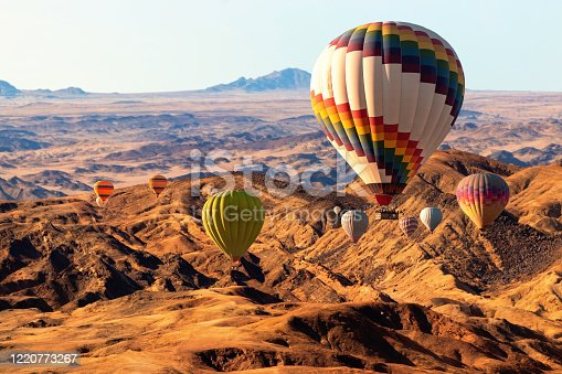 530709531 istock photo Colorful hot air  balloons flying over the moon valley mountain. Africa. Namibia. 1220773267