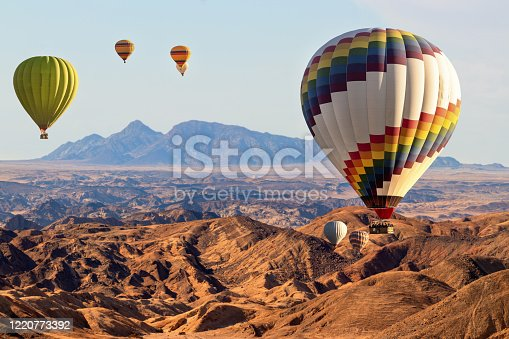 530709531 istock photo Colorful hot air  balloons flying over the moon valley mountain. Africa. Namibia. 1220773392