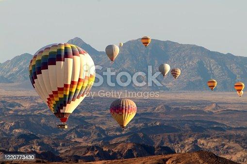 530709531 istock photo Colorful hot air  balloons flying over the moon valley mountain. Africa. Namibia. 1220773430