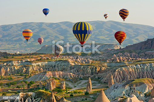 istock Colorful hot air balloons flying over the valley at Cappadocia, 498144796