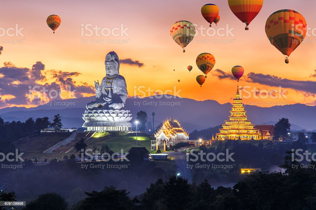 Colorful hot air balloons flying over Wat Huay Pla Kang stock photo