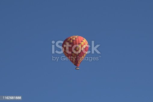 844061492 istock photo Colorful hot air balloons flying 1162681888