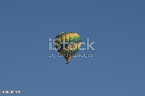 844061492 istock photo Colorful hot air balloons flying 1162681889