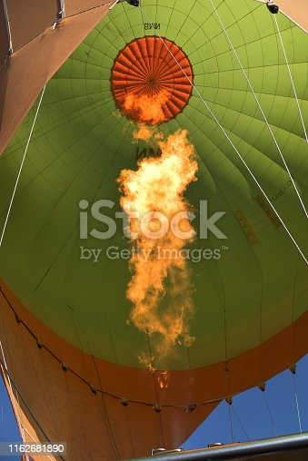 844061492 istock photo Colorful hot air balloons flying 1162681890