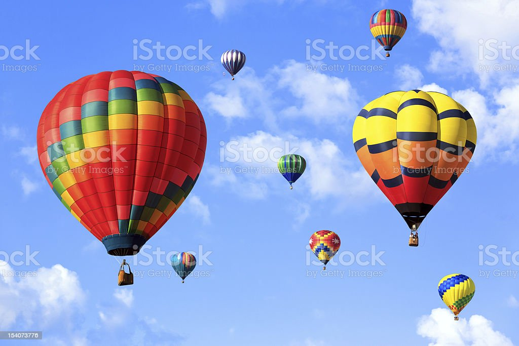 colorful hot air balloons over the cloudy sky
