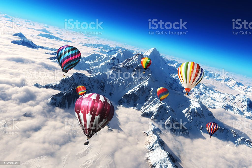 Colorful hot air balloon's soaring above a snow mountain scape. stock photo