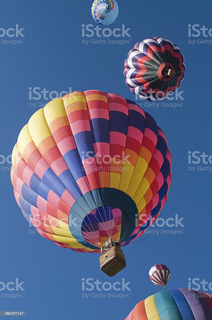 Colorful Hot Air Balloons Taking Off Overhead royalty-free stock photo