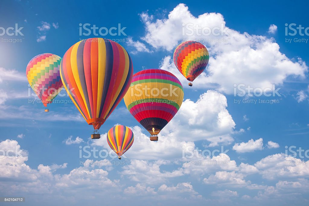 Colorful hot-air balloons flying in the blue sky stock photo