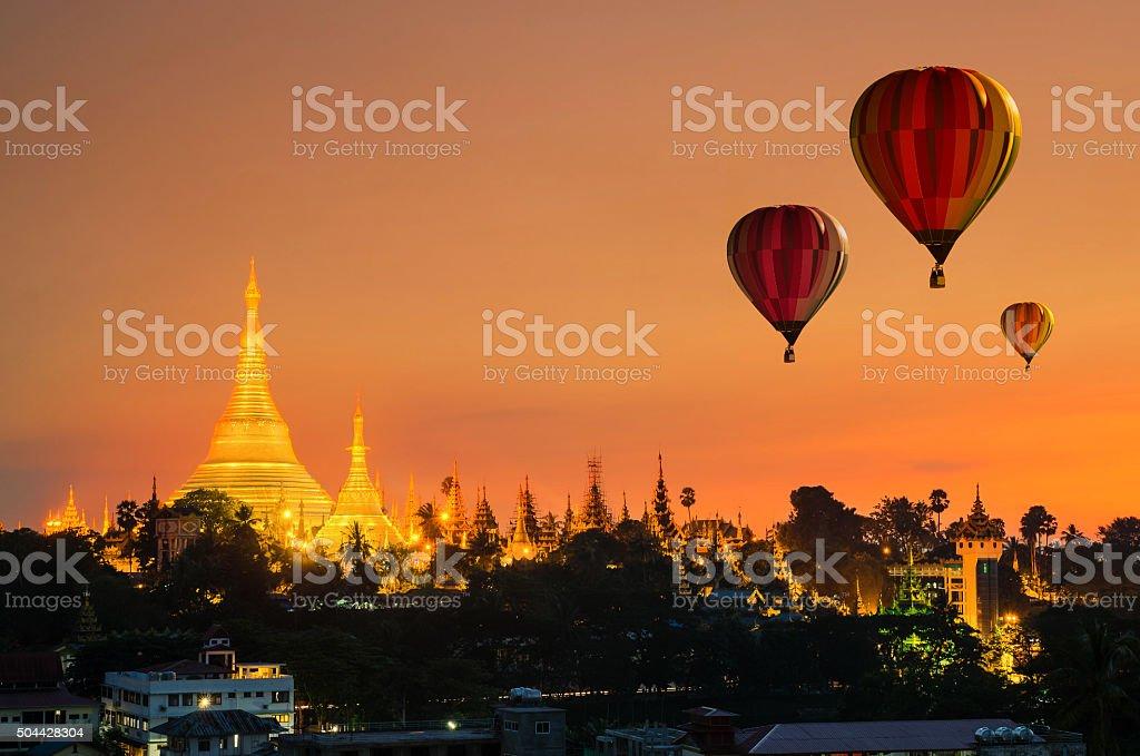 Colorful hot-air balloons flying over of Shwedagon Pagoda at Yan stock photo