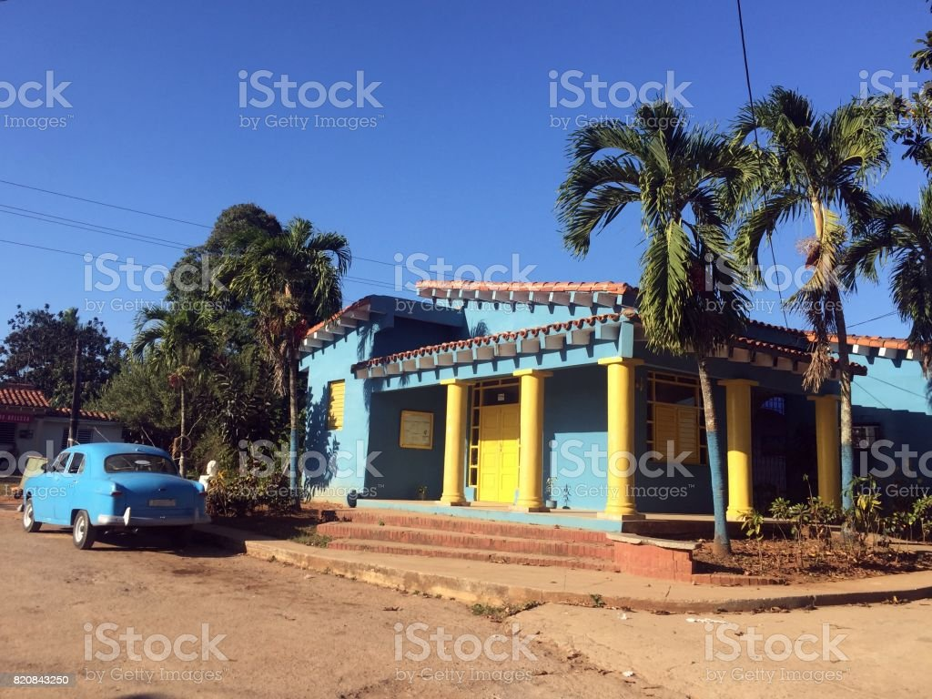 Colorful house and vintage car in Vinales stock photo