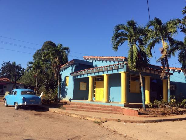 Colorful house and vintage car in Vinales