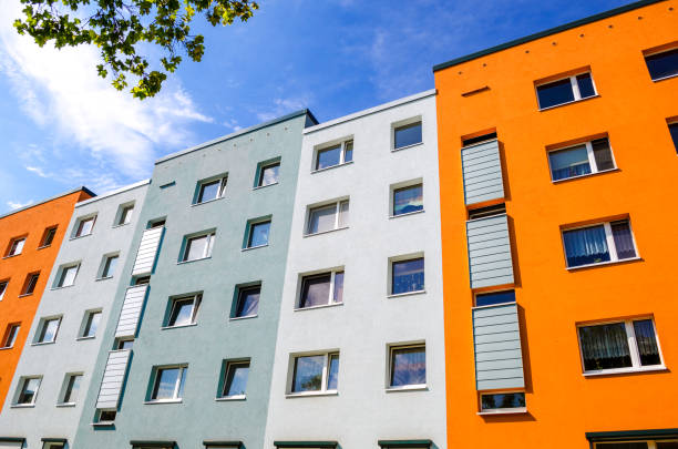 Colorful house facades with windows of apartment buildings stock photo