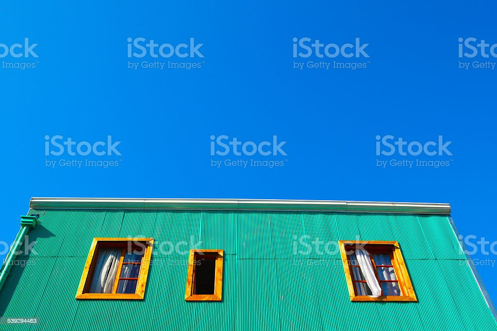 Colorful house with three windows in valparaiso royalty-free stock photo