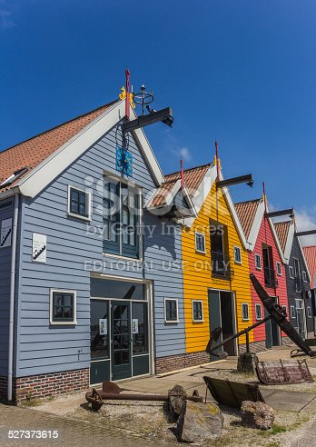 istock Colorful houses against a bright blue sky 527373615