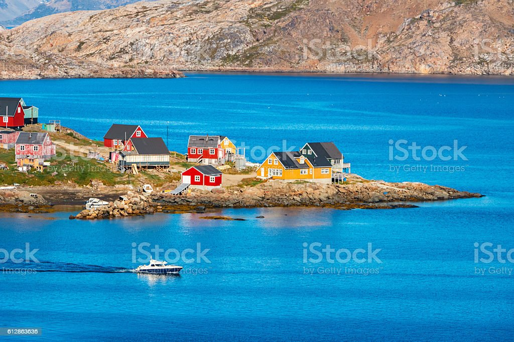 Colorful Houses and Boat in Kulusuk Greenland stock photo