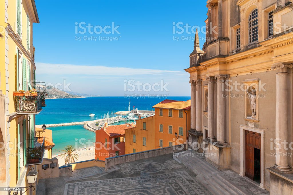 Colorful houses and Mediterranean sea in Menton. stock photo