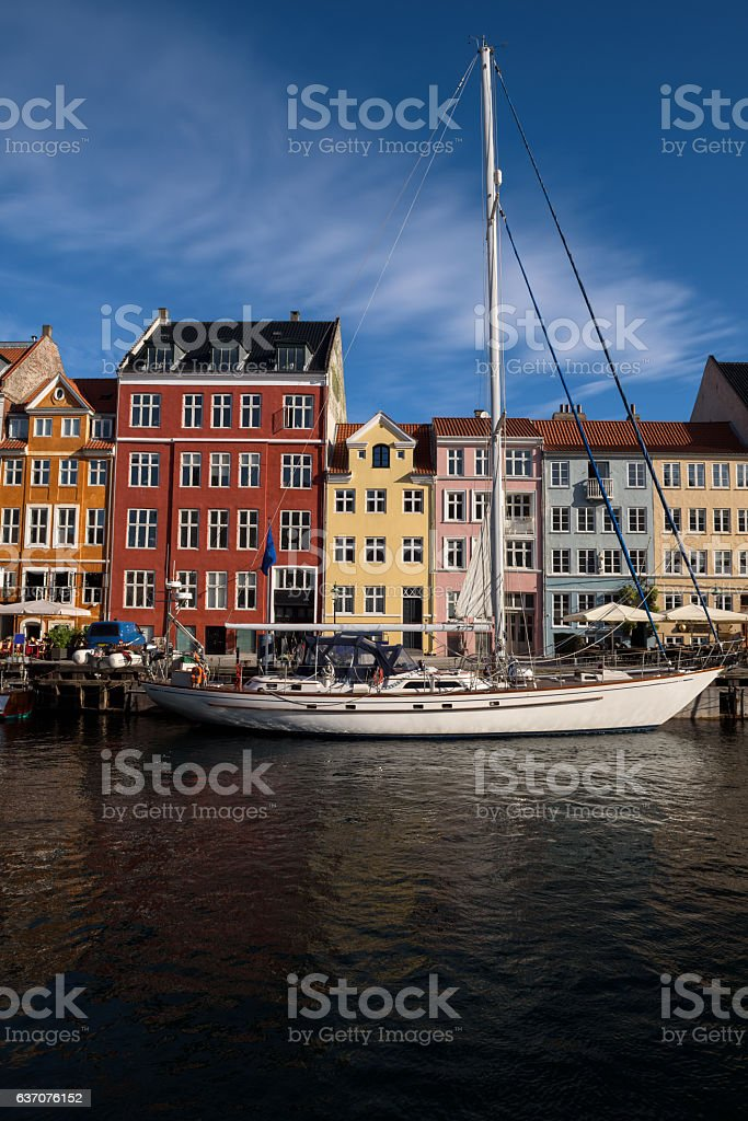 Colorful houses at the canals of Nyhavn in Copenhagen stock photo