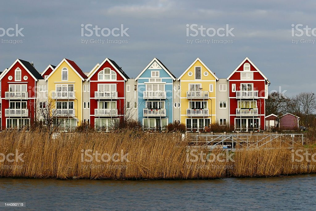 Colorful houses beside a river royalty-free stock photo