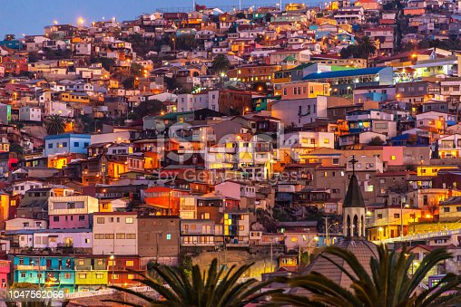 istock Colorful houses illuminated at night on a hill of Valparaiso, Chile 1047562066