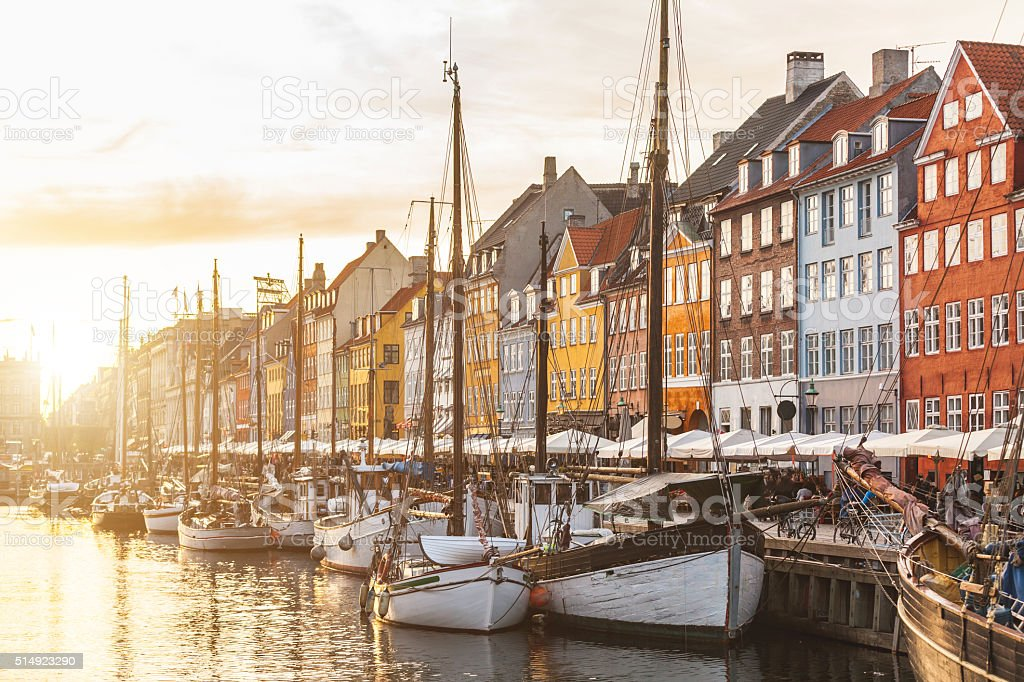 Colorful houses in Copenhagen old town at sunset stock photo