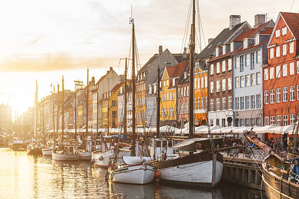 colorful houses in copenhagen old town at sunset - denmark stock photos and pictures