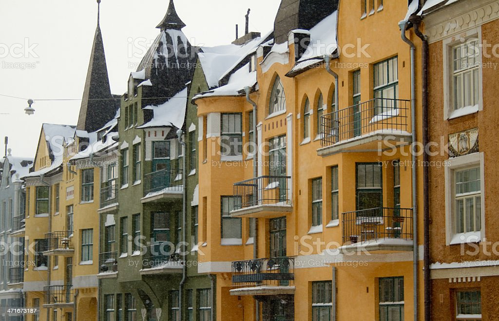 Colorful houses in snowfall stock photo