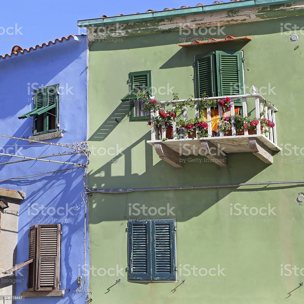Colorful houses in the small harbor of Giglio Island stock photo