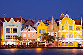 The coloured houses of Willemstad, Curaçao in the Netherlands Antilles by night.