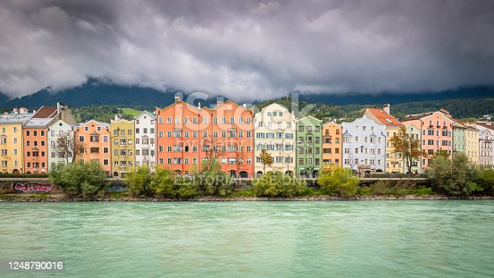 Innsbruck, Austria - September 25, 2019: On Mariahilf Street along the Inn River in Innsbruck, there is a row of houses. The city is called Innsbruck because of the river Inn flowing throught the city