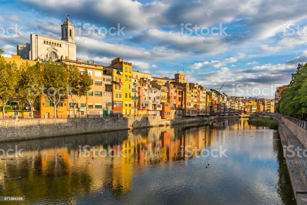 Colorful houses on the banks of the Onyar river in Girona stock photo