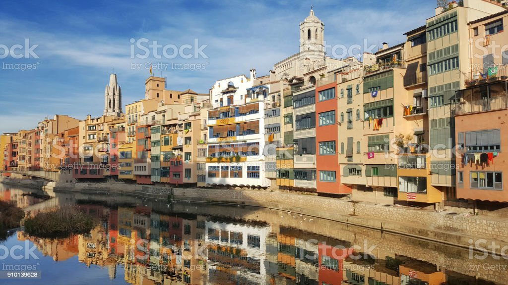 Colorful Houses Reflecting on the Onyar River stock photo
