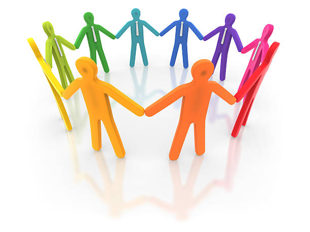Colorful human figures holding hands in a circle stock photo