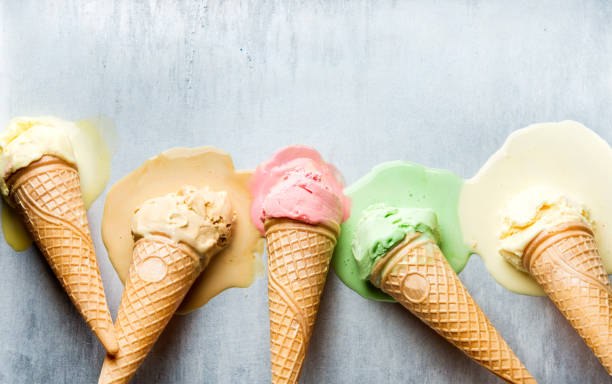 Colorful ice cream cones of different flavors. Melting scoops. Top view,  steel metal backgroun Colorful ice cream cones of different flavors. Melting scoops. Top view, copy space, steel metal background melting stock pictures, royalty-free photos & images
