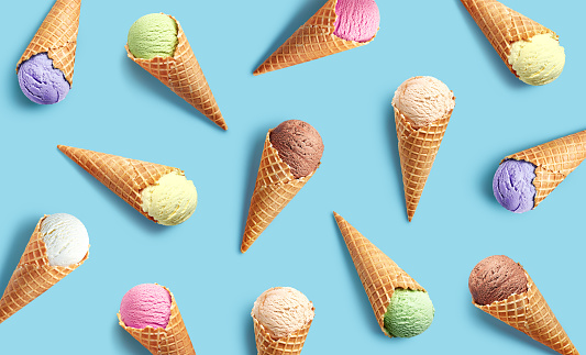 Colorful ice cream pattern on blue background, top view, flat lay