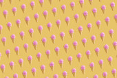 Colorful ice cream pattern on yellow pastel background. Summer concept.