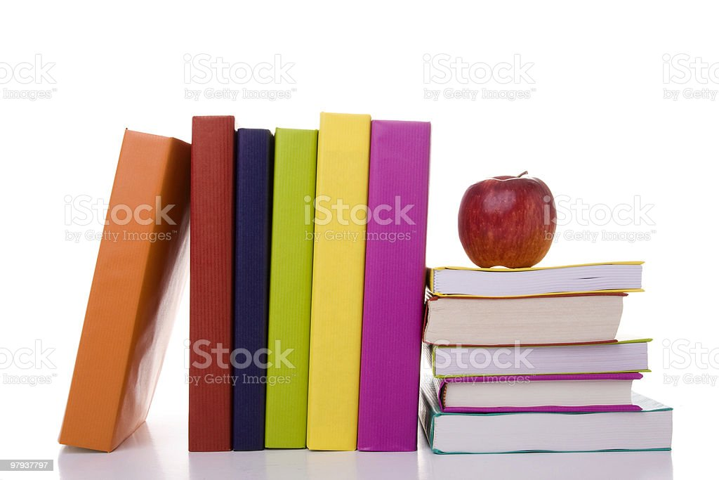 Colorful image consists of one red apple on a stack of books royalty-free stock photo