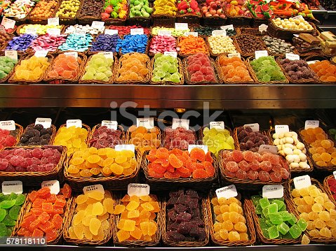 Colorful image of various sweets, candied fruit jelly at market stall
