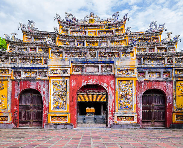 Colorful imperial city gate, Hue, Vietnam Impressive gate in the old citadel of Hue, the imperial forbidden purple city huế stock pictures, royalty-free photos & images