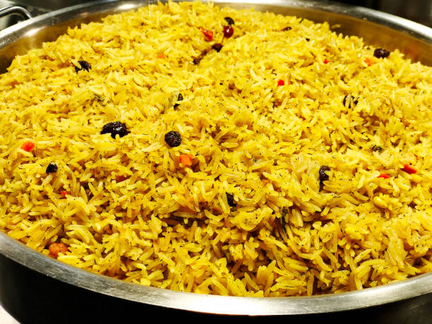 A colorful Indian rice dish made from basmati rices spices and fresh vegetables stock photo