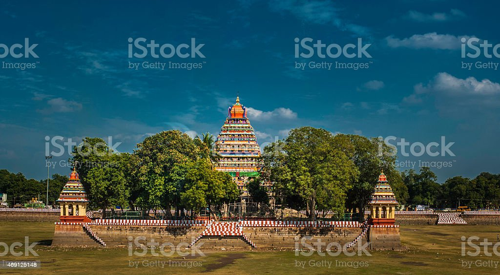 Colorful Indian Temple in middle of Field stock photo