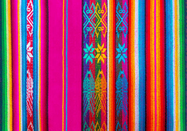 Colorful Indigenous Andes Textile, Cusco, Peru The colorful indigenous or Quechua textiles and fabrics traditional for the Andes mountain range can be found in Peru, Ecuador and Bolivia. Detail of one textile form the local art and craft market of Cusco, Peru. peruvian culture stock pictures, royalty-free photos & images