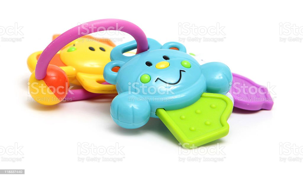 A colorful infant's rattle toy on a white background  stock photo