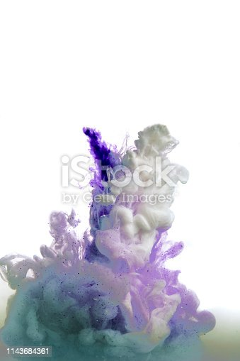 istock Colorful ink. purple blue drop swirling under water. Cloud of ink in water. abstract background 1143684361