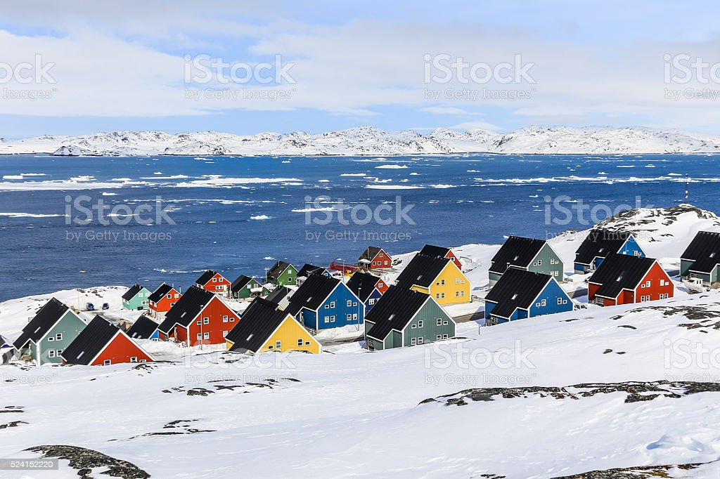Colorful inuit houses in a suburb of arctic capital Nuuk stock photo