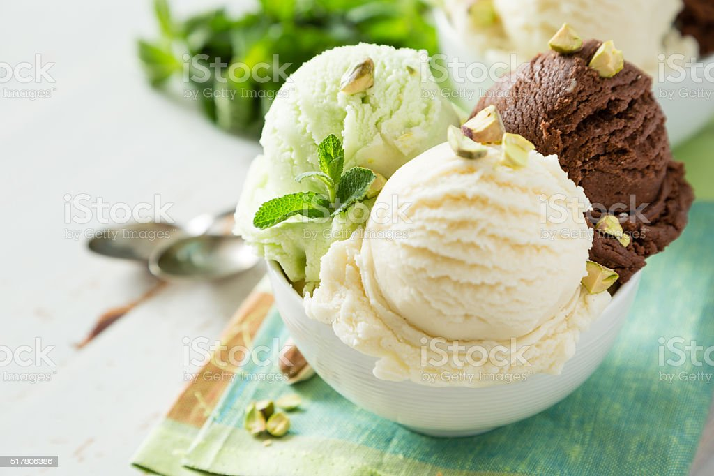 Colorful ive cream scoops in white bowl stock photo