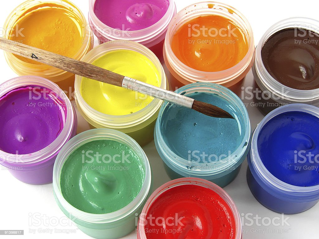 Colorful jars of gouache paints with a brush royalty-free stock photo